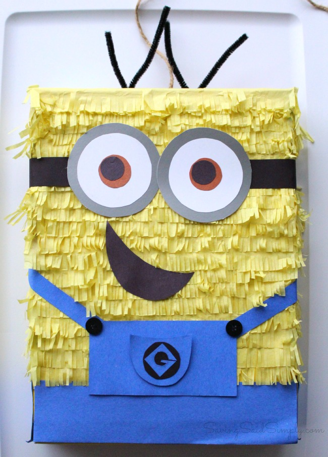 DIY minions pinata DIY Minion Pinata | Great ready for the new Minions Movie with this easy DIY Minions Pinata! Frugal Despicable Me party idea for the kids #PartyPlanning #Minions #KidsParty