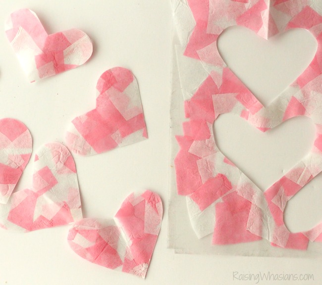 Easy valentines day craft toddler Mosaic Heart Valentine's Day Banner Kids Craft | make this adorable and easy Valentine's day craft for kids. Perfect heart banner to hang in the window. #kidscraft #valentines #DIY #Crafts