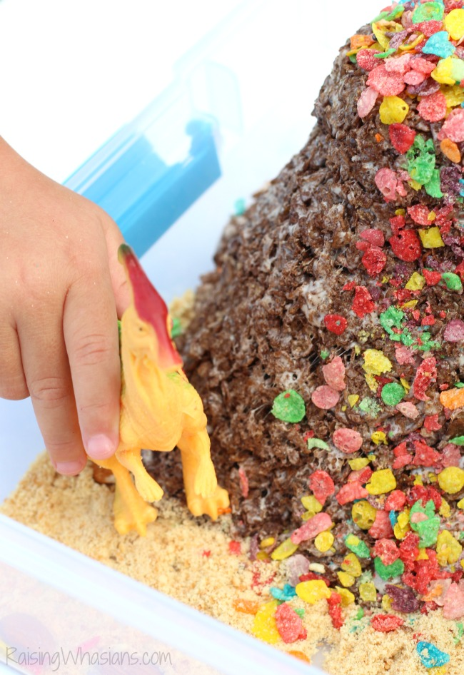 Dinosaur Sensory Bin with Edible Volcano | Fun kids activity and snack in one! DIY Dinosaur Sensory Bin + Edible Volcano Recipe with Cocoa & Fruity Pebbles - Sensory play idea for kids. This preschool sensory play idea is non toxic and edible for kids - #Recipe #SensoryPlay #Preschool #KidsActivities