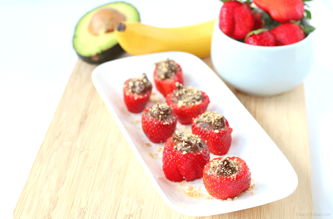 "Kid approved strawberry snack idea Skinny Chocolate Stuffed Strawberries | An easy & healthy dessert that's kid-approved! Lower sugar and lower calories + a ""Secret"" avocado ingredient for a no-guilt treat! #HealthySnack #Recipe #HealthyRecipes #kidsSnacks"